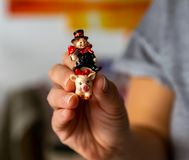 Woman is holding a lucky charm in her hand, a chimney sweep on a pig royalty free stock images