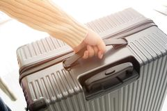 Woman holding luggage bag. Travel concept Stock Images