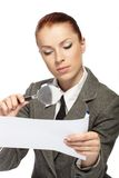 Woman holding a magnifying glass Stock Photos