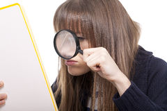 Woman holding a magnifying glass Stock Image