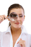 Woman holding magnifying glass Stock Photography