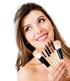 Woman holding make up brushes Stock Photo