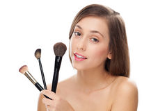 Woman holding make-up brushes Royalty Free Stock Image