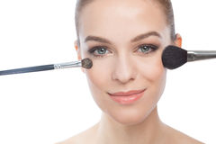 Woman holding make up brushes Royalty Free Stock Images