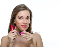 Woman holding make-up preparations Stock Images