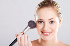 Woman holding makeup brush Royalty Free Stock Photography