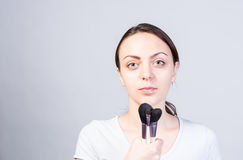 Woman Holding Makeup Brushes Like Microphone Stock Photos