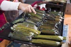 Woman holding Malaysian famous delicacies called pullut panggang Stock Photos