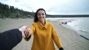 Woman holding man hand smile on beach. stock video