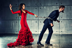Woman holding man on heavy chain Royalty Free Stock Photos