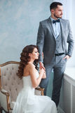 A woman holding a man`s hand. Bride in beautiful dress and groom Stock Images