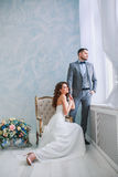 A woman holding a man`s hand. Bride in beautiful dress and groom Royalty Free Stock Photo