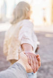 Woman holding man's hand. Royalty Free Stock Images