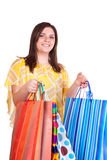 Woman holding many bags Stock Photo