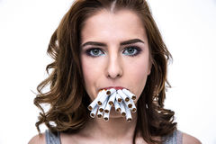 Woman holding many cigarettes in the mouth Stock Photography
