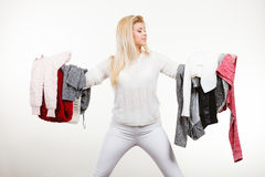 Woman holding many clothing Royalty Free Stock Images