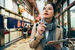 Woman holding map guidebook searching for place. Japan osaka city urban tourist woman holding map guidebook searching for the shogi place for trying japanese stock photos