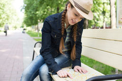 Woman holding a map in the park Royalty Free Stock Photography