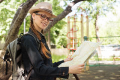 Woman holding a map in the park Stock Photography