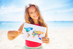 Woman holding a map royalty free stock photos