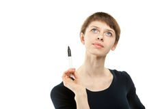 Woman holding marker and thinking. Portrait of attractive young woman holding black marker and thinking looking up, copy space; isolated on white Stock Photos