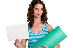 Woman Holding a Mat and a White Empty Card Stock Photography