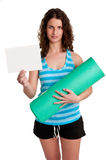 Woman Holding a Mat and a White Empty Card Royalty Free Stock Photos
