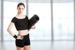 Woman Holding a Mat Stock Photography