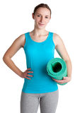 Woman Holding a Mat. Woman holding a yoga mat, isoalated in a white background Royalty Free Stock Photo