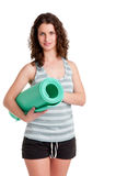 Woman Holding a Mat. Woman holding a yoga mat, isoalated in a white background Stock Images
