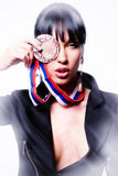 Woman holding a medal Stock Photo