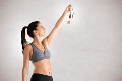 Woman Holding a Medal Royalty Free Stock Photography