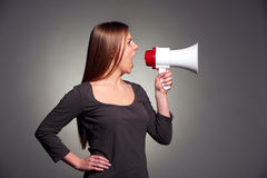 Woman holding megaphone Royalty Free Stock Photo
