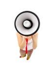 Woman holding megaphone and yelling. Fisheye lens, studio shot Royalty Free Stock Photo