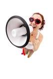 Woman holding megaphone and yelling. Fisheye lens, studio shot Royalty Free Stock Photography