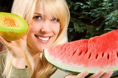Woman Holding Melons Royalty Free Stock Photo