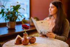 Woman holding menu while sit in cafe Stock Images