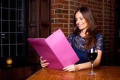 Woman holding a menu Stock Photo
