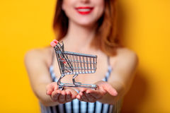 Free Woman Holding Metal Shopping Cart Stock Photography - 93836532