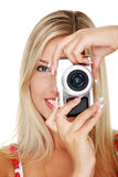 Woman holding a micro four thirds photo camera. Young beautiful smiling blond woman holding a micro four thirds photo camera. Isolated over white background stock photos