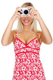 Woman holding a micro four thirds photo camera. Royalty Free Stock Image