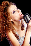 Woman holding microphone Stock Image