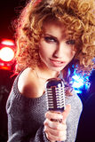 Woman holding microphone Royalty Free Stock Photo