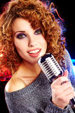 Woman holding microphone Stock Photo