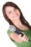 Woman holding a microphone Stock Photos