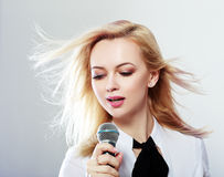 Woman holding microphone Stock Photography