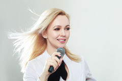 Woman holding microphone Stock Photos