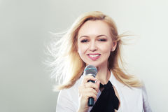 Woman holding microphone Royalty Free Stock Images