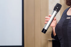 Woman holding microphone Royalty Free Stock Photos
