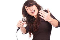 Woman holding a microphone and singing loud Royalty Free Stock Photography